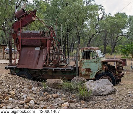 Rusted Decaying Vintage Truck With Disused Mining Equipment On The Back