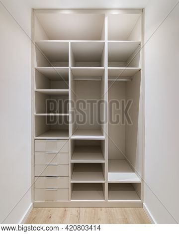 New Built-in Furniture In A Small Dressing Room. Modern Storage Room With Wardrobe, Many Shelves And
