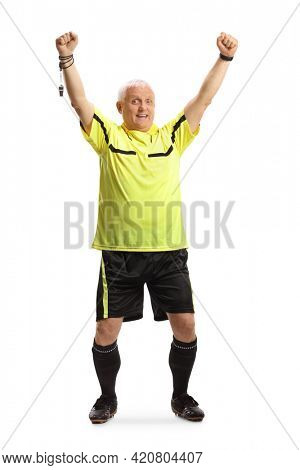 Full length portrait of a mature football referee cheering with hands up isolated on white background