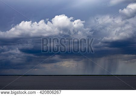 Rainy Clouds Over The River. Dark Cloud In Rainy Weather Over The River. Storm Clouds Over Horizon.