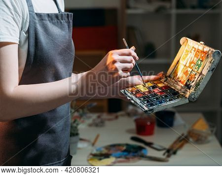 Art Studio. Female Artist. Choose Color. Painting Process. Unrecognizable Woman Holding Box With Col