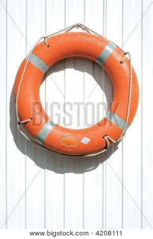 Orange Lifebuoy On Fence