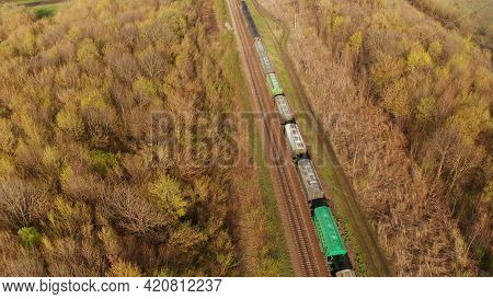 A Train That Carries A Train Of Freight Cars. Train Travel By Rail. Birds-eye. A Train With Boxcars