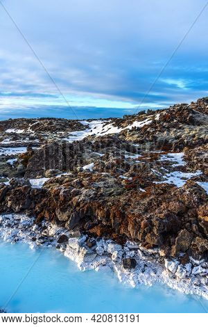 Unique Landscape With Lava Fields And Blue Thermal Water In Iceland. Outside Blue Lagoon In Iceland.