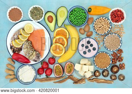 Health food and herbal medicine to stabilise bipolar disorder and manic depression with foods high in omega 3, protein, vitamins, selenium, magnesium, serotonin and tryptophan. Health care concept.