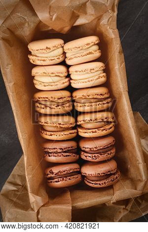 Brown, Beige And Cream Colored French Macarons With Coffee, Mocha, Chocolate And Vanilla Flavor In T
