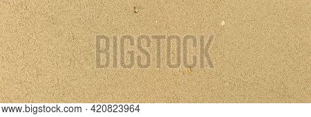 Panorama Of Light Brown Fine-grained Sand On The Beach Texture And Background Seamless