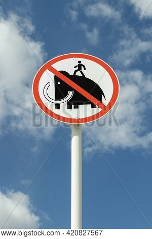 The Sign Is Not To Walk On Mammoths Art Objects Against The Sky.