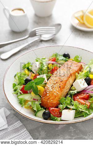 Salmon Fish Salad. Fresh Vegetable Greek Salad With Tomato, Pepper, Lettuce, Olives, Cucumbers, Feta