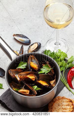 Traditional seafood mussels in wine sauce and toasts. With copy space