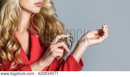 Woman Holding A Perfumes Bottle. Woman Presents Perfumes Fragrance. Woman With Perfum Bottle. Beauti