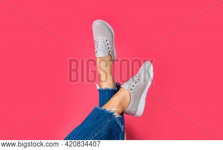 Female Feet In Sporty Comfortable Shoes With Laces, Shoe Fashion
