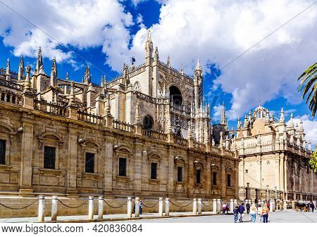 Seville, Andalusia, Spain - May 18, 2013: South Facade With Prince Door Rose Window Towers Gothic Se