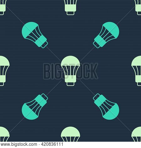 Green And Beige Led Light Bulb Icon Isolated Seamless Pattern On Blue Background. Economical Led Ill