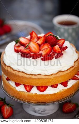 Victoria`s Sponge Cake, Delicious Homemade Vanilla Cake Decorated With Whipped Cream And Fresh Straw