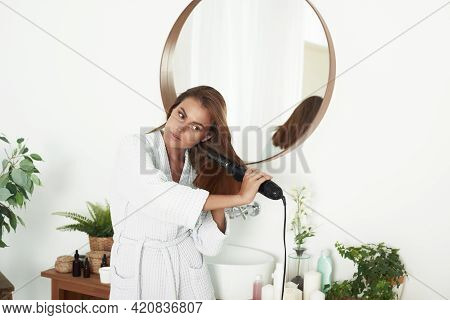 Hair Care. Beautiful Long Haired Woman Drying Using Hair Dryer Near Mirror At Home In Bathroom