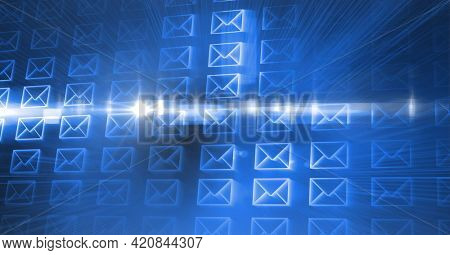 Composition of digital mail envelopes on glowing blue background. global networks and digital interface concept digitally generated image.
