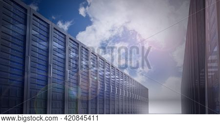 Multiple computer servers over blue sky background, data processing and technology concepts. digitally generated image