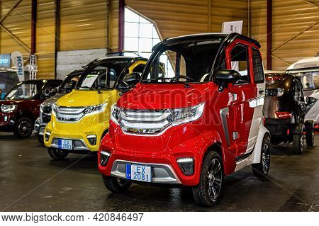 Riga, Latvia, September 25, 2020: Dt Motor Power One Mini Electric Cars At A Motor Show
