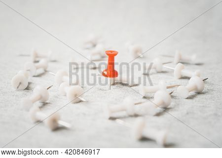 Standing Red Thumbtack Among Blurred  White Thumbtacks On Grunge Grey Background , For Outstanding L