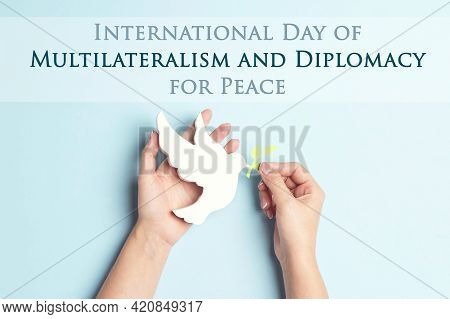 International Day Of Multilateralism And Diplomacy For Peace,april 24. Female Hands Hold Dove Of Pea