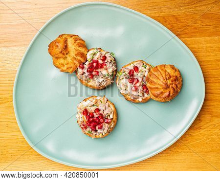 canape with meat salad and pomegranate seeds
