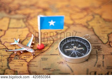 Airplane Flag, Compass And Airplane On The World Map And Airplane.