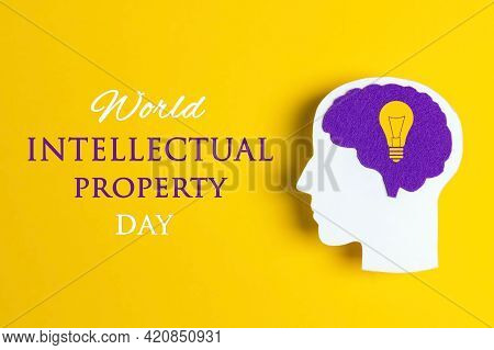 World Intellectual Property Day, April 26. Poster With Head Silhouette With A Purple Brain And Light