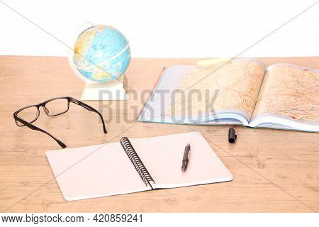 In The Office There Is A Globe And A Map Of The World On The Table For Choosing A Market For Product