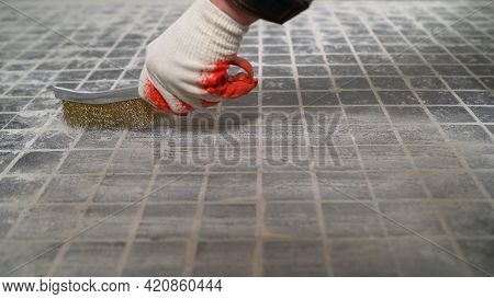 Rigid Metal Brush Attachment For Cleaning Hard Surfaces. A Worker Works With A Brush With Metallic H