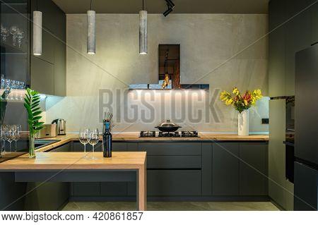 Modern luxury loft studio apartment interior with dark grey kitchen