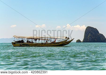 Boat ride to James Bond Island. Ko Tapu, Thailand. Travel to a fabulous warm country. Warm gentle Andaman sea, picturesque cliffs overgrown with moss and grass.