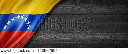 Venezuela Flag On Black Wood Wall. Horizontal Panoramic Banner. 3d Illustration