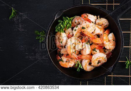 Fried Prawns. Roasted Shrimps In Skillet With Lemon, Parsley And Garlic. Top View, Overhead