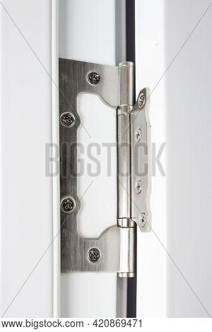 Stainless Door Hinges On A White Door. Hinges On The White Door.
