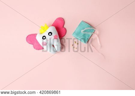 Tooth Fairy With Magic Wings And Crown On Pink Background, Greeting Card With Copy Space Happy Tooth