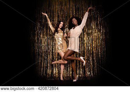 Full Length Photo Of Brunette Stunning Girls Hold Champagne Raise Hand Wear High-heels Isolated On S
