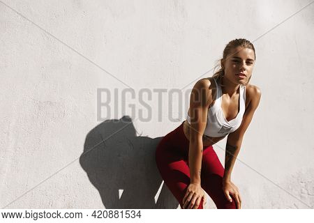 Sweaty Fitness Girl Taking Breath On Morning Jogging. Female Athlete Runner Resting, Workout Outdoor