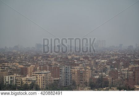 View On The City Of Giza In A Morning With Smog, Outskirts Of Cairo, As Seen From The Giza Plateau.