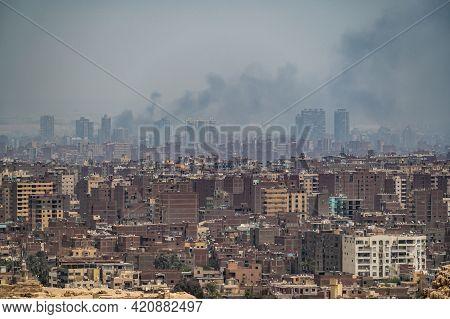 Pollution Over Cairo City. Smog, Smoke, Fog, Over An Arab City. Problem Air Pollution. Aerial View M
