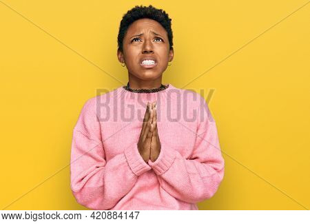 Young african american woman wearing casual clothes begging and praying with hands together with hope expression on face very emotional and worried. begging.