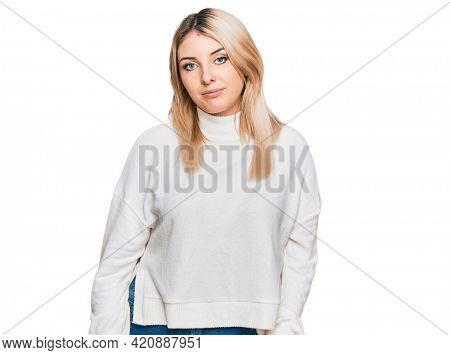 Young caucasian woman wearing casual winter sweater looking sleepy and tired, exhausted for fatigue and hangover, lazy eyes in the morning.