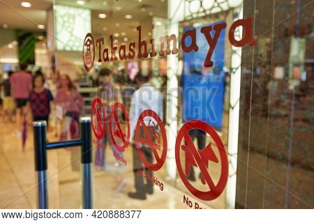 SINGAPORE - CIRCA JANUARY, 2020: close up shot of Takashimaya sign and prohibition signs as seen in Nge Ann City shopping center.