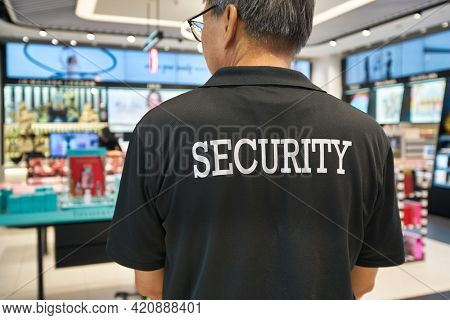SINGAPORE - CIRCA JANUARY, 2020: close up shot of SECURITY sign on the black T-shirt seen at Sephora store in Nge Ann City shopping center.