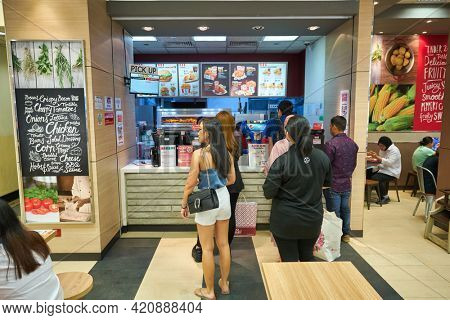 SINGAPORE - CIRCA JANUARY, 2020: counter service at KFC in Nge Ann City shopping center.