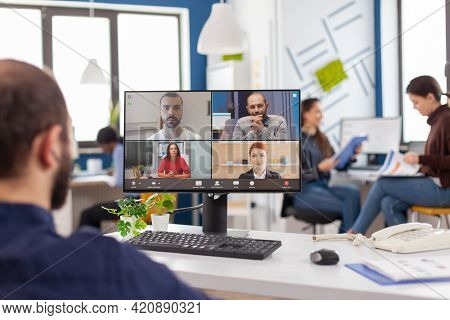Immobilized Entrepreneur Project Manager In Wheelchair Talking On Videocall During Online Meeting Di