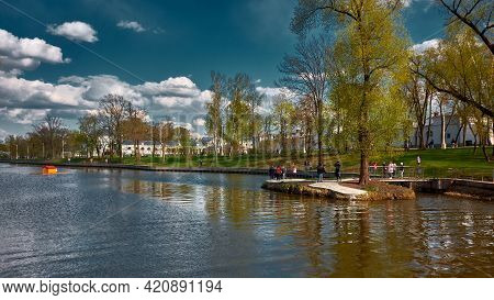 Vacationers On The Banks Of The Kamenka River, Vdnh, Public Park, Landscape: Moscow, Russia - May 07