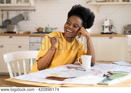 Cheerful Black Business Woman Laugh Work Remotely From Home Office. Carefree African Female Architec