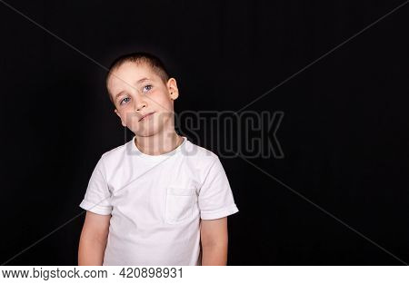 Portrait Of Cheerful Kid Boy Isolated Over Black Background. Portrait Of A Five Year Old Boy Posing.