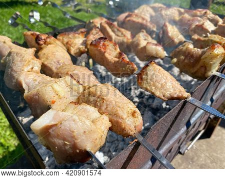Delicious Beautiful Fried Pork Skewers On The Smoke Cooked On The Grill With Skewers With Coals. Bar